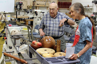 Photo: Jack Enders and Margaret Follas view some of Demonstrator Eliot Feldman's display pieces before the Meeting.