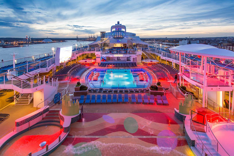 A view of the main pool deck on Anthem of the Seas at sunset — beautiful!