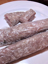 Photo: nitrate-free home-made naem sour sausage is less red/pink than the store-bought kind