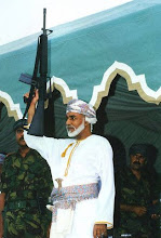 Photo: Original caption: Qabus Ibn Said celebrates the Aid El Kebir with a gun in his hand. March 27, 1999