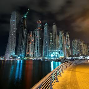 Dubai Marina at night in United Arab Emirates by Péter Mocsonoky - Buildings & Architecture Office Buildings & Hotels ( illuminated, arabic, emirates, skyline, arab, futuristic, architecture, cityscape, travel, middle, business, city, modern, lights, sky, skyscraper, dubai, buildings, marina, east, evening, downtown, water, office, building, united, sea, tourism, luxury, holiday, urban, landmark, tower, bay, contemporary, uae, popular, background, scene, night, view )