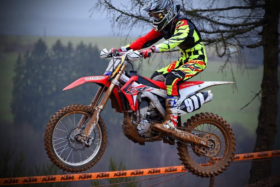 Jump by Marco Bertamé - Sports & Fitness Motorsports ( mud, bike, rainy, wheel, motocross, weather, helmet, jump,  )