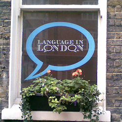 a sign in a window with thought bubble saying language is london
