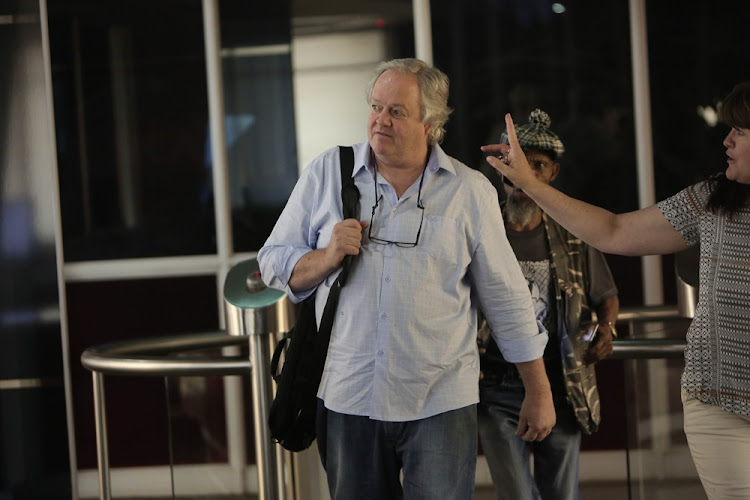 Veteran journalist and author of 'The President's Keepers', Jacques Pauw, leaves the eNCA offices in Hyde Park, Johannesburg on 7 November 2017.