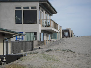 Photo: Other houses along our beach.