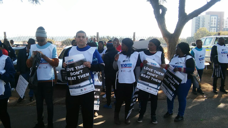 Marchers at the 100 Men March in Pretoria on July 10, 2018.