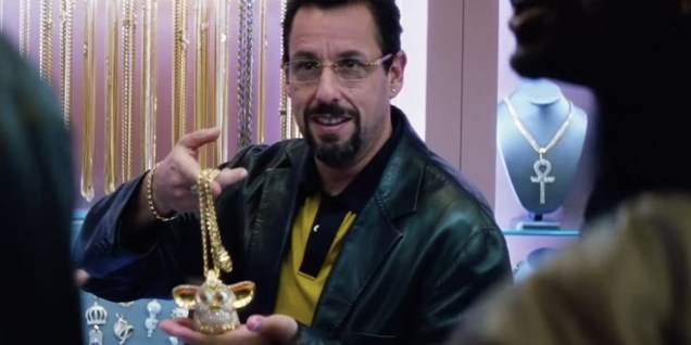 Uncut Gems Adam Sandler shows off a golden Furby