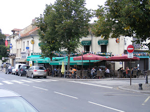 Photo: Lunch today is a tasty roast pork and frites on this local spot on the Place Fouillère, the portside center of town. The town market has been held here since 1859, and the square expanded just a year later and planted with linden trees.