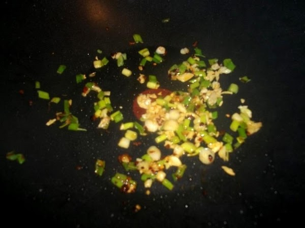 Place another 1 - 2 tsp sesame oil in wok and heat back up,...