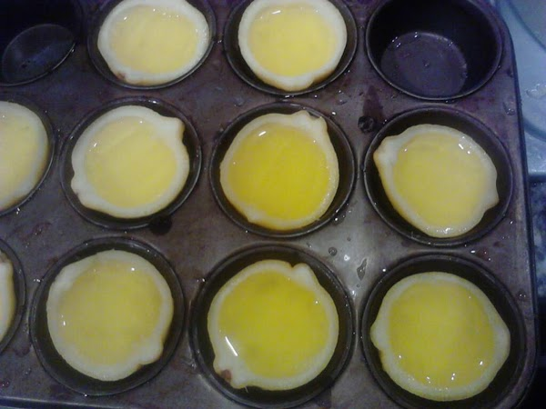 Pour the Jello mixture into each lemon half so that they are completely full....