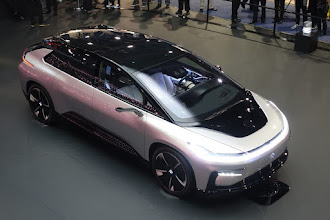 Photo: The much talked about Faraday Future FF91.  Note the side view mirrors, planning for the day (coming soon) when you are not required to have those and can use cameras instead.    Also of interest is the circle you can see on the hood, where a LIDAR pops out for future robocar modes.