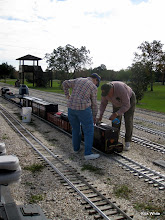Photo: Mary Lou and Jerry Schoenberg polishing the PRR loco    SWLS at HALS 2009-1107