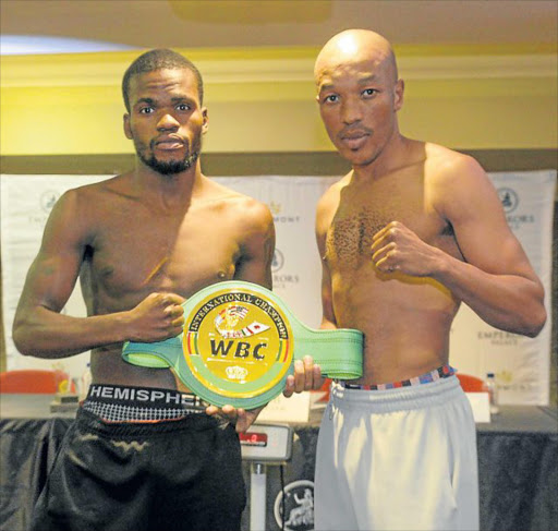 POINT TO PROVE: Simphiwe Vetyeka, right, seen here with his opponent Lerato Dlamini, ahead of their Super Four clash Picture: GALLO IMAGES