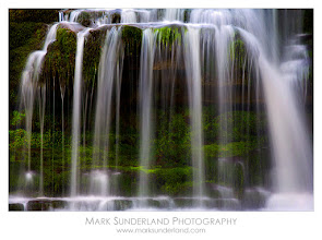 Photo: #WaterfallWednesday  West Burton Waterfall in Spring  For Waterfall Wednesday I just had to share this image of my favourite little waterfall tucked away in the corner of the village of West Burton in the Yorkshire Dales. West Burton Falls, also known as Cauldron Falls, is a delight to photograph year round. This image was made in early spring, without leaves on the surrounding trees, so I got in close to concentrate on the moving water and the moss on the rocks behind it.  Canon EOS 5D, 70-200mm, ISO 50, 1s at f22