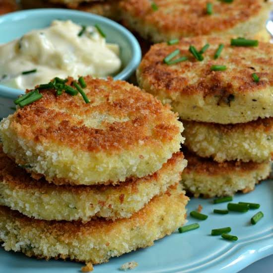 Potato Croquettes Are Crisp Fried Breaded Mashed Potato Patties.  Parmesan Cheese And Chives Are Added To The Potatoes To Provide The Ultimate Taste Bud Experience.  Two Minute Garlic Aioli Dipping Sauce Takes This Over The Top!