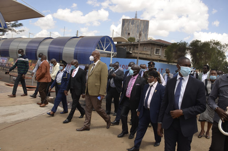 Acting Nairobi Governor Benson Mutura and Nairobi Metropolitan Service Director General Mohammed Badi escorted by MCAs as they tour Green Park terminus on December 21, 2020