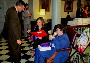 Photo: Advocates Dafne Carnright and Cheri Will provide information regarding Disability Day at Legislative Hall.