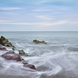 Sun going down and the tide going out by John Holmes - Landscapes Waterscapes ( cork, long exposure, sea, peacefull, sand, minimal, pastel, rocks, youghal, beach, sunset, coastal, ireland, solitude )