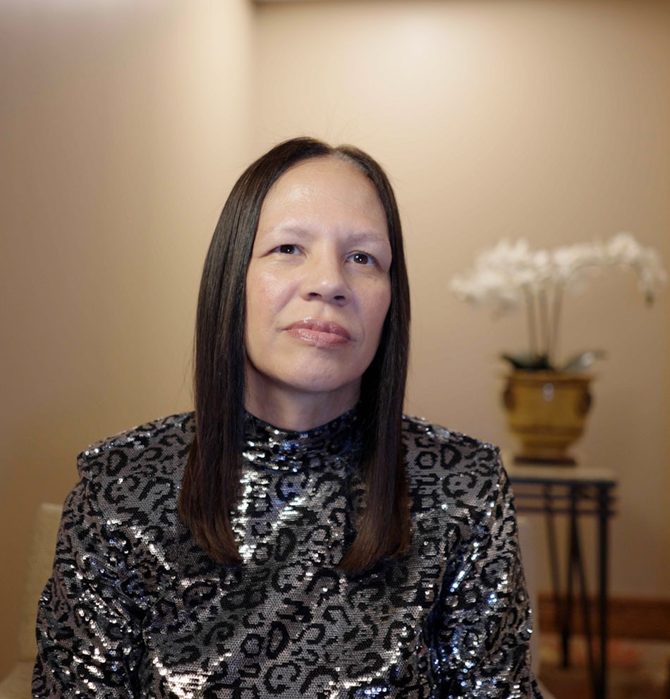 Cassandra Johnson is the Vice President of Customer Care & Vendor Management Office at Google. Cassandra has long, straight black hair and is wearing a sequined leopard print jacket.