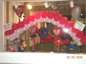 Photo: tiara arch (hung in store display window) -weddings, head table, entrances, parties, you name it!