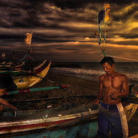 preparing nets by Dian Anugrah - People Portraits of Men ( clouds, child, afternoon, the nets, boats, the beach, workers, the sea )