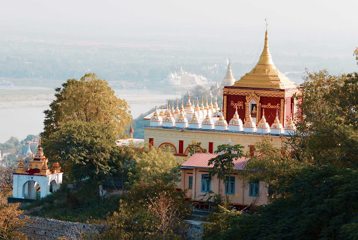 myanmar-pagoda-in-hillside.jpg - One of the temple complexes along the Irrawaddy River or Ayeyarwady River, Myanmar's main waterway.