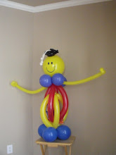 Photo: Smiley sculpture (tummy can be filled with goodies, other balloons, etc.)