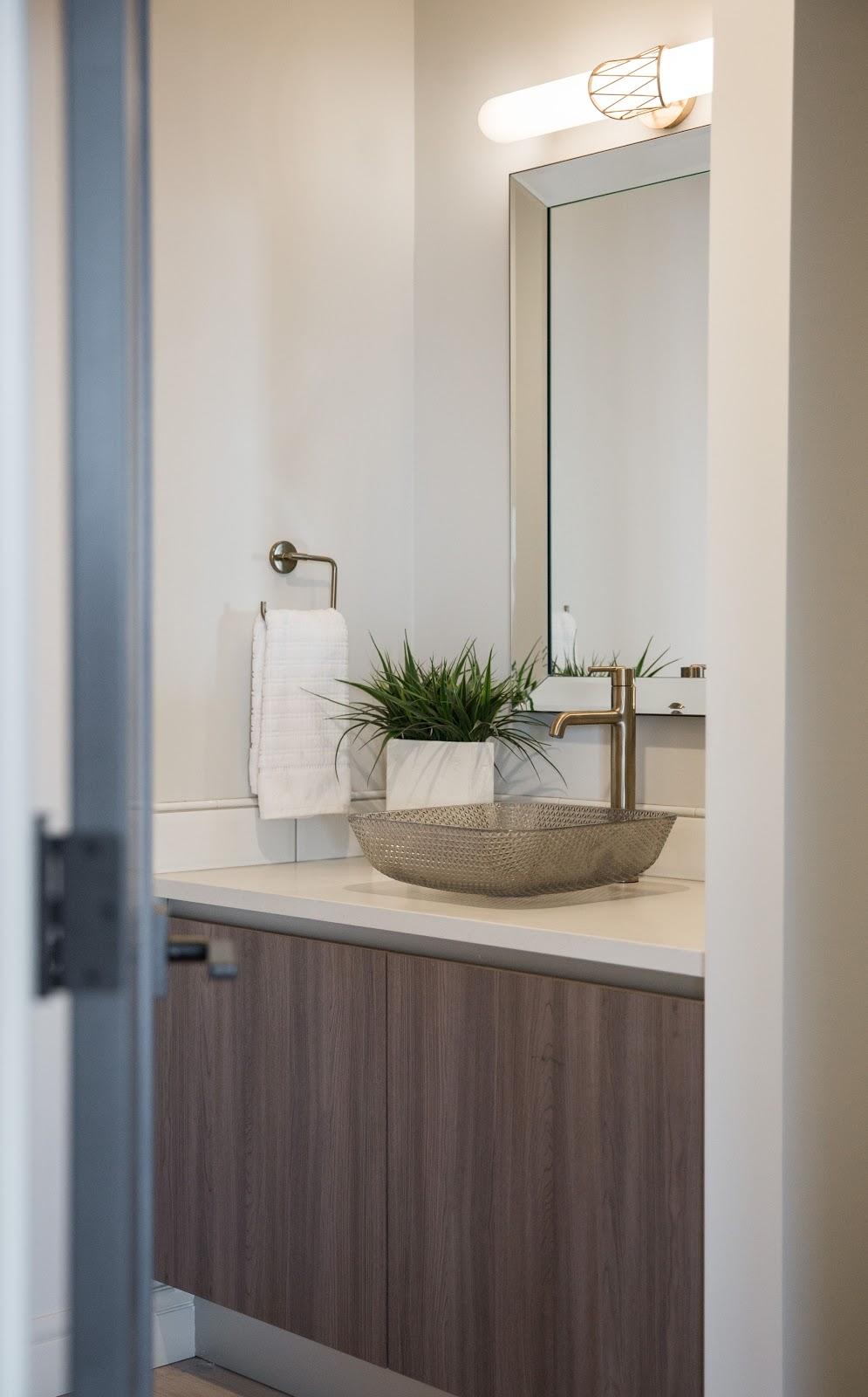 Calgary interior design modern traditional cosy elegant powder room wow factor gold sink golden filigree lighting