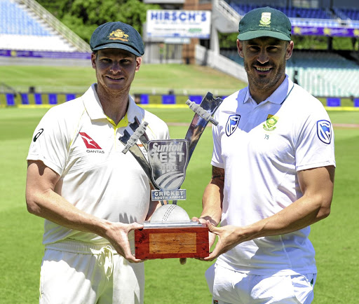 Ready for action: Steven Smith, left, and Faf du Plessis with the trophy SA and Australia will be playing for in the four-Test series. Picture: GERHARD DURAAN/GALLO IMAGES