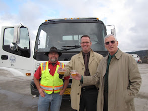 Photo: Medford City Manager Eric Swanson and Bill Hoke, deputy city manager, join driver Randy Schock for the City of Medford's CNG street sweeper, the first in the region.