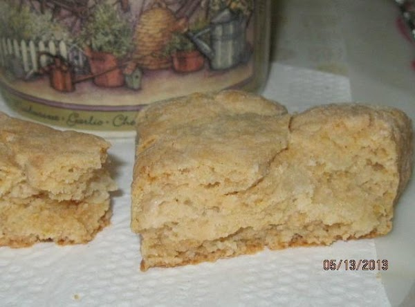 They will be lightly browned on the bottom.  Remove immediately from the baking...