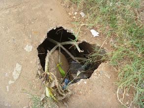 Photo: a hole in the sidewalk