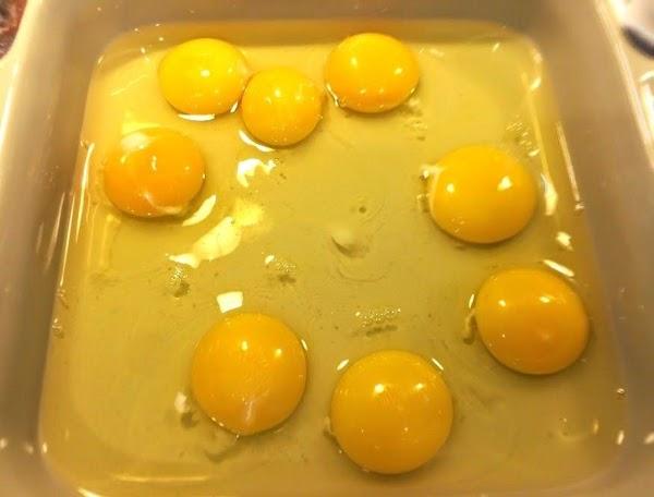 Add eggs into a square pan.