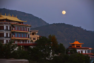 Photo: Adorned by the full moon, Sowa Rigpa Medical Institute now stands quietly in elegance against the backdrops of mountains and Yongdrung Bon Monastic Library at Menri Monastery in India.