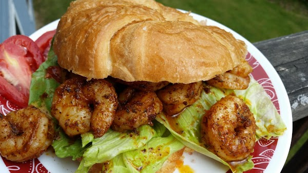 Slice your croissants, lay lettuce on the bottom halve and place desired shrimp to...