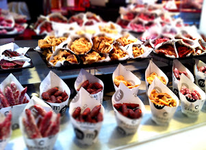 Photo: Mercado de San Miguel.  Gourmet market food market with a great selection of Spanish  foods and drinks for sampling.  Ham and sausage!  Madrid.