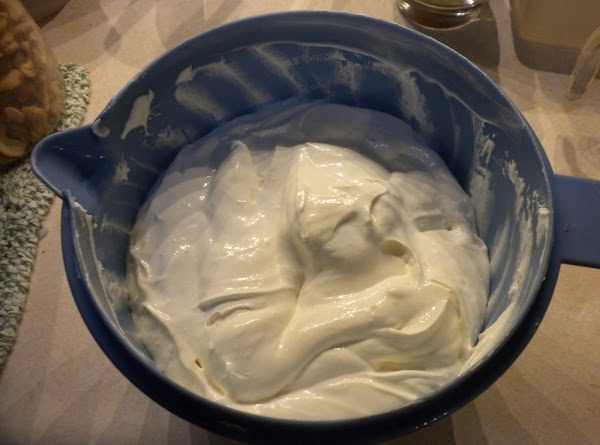 Blend together the cream cheese, lemon juice and sweetened condensed milk. Gently fold in...
