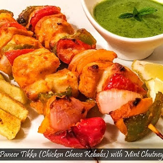 Chicken Paneer Tikka (Chicken Cheese Kebabs) with Mint Chutney.