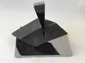 Photo: WEDGE IMPACTING RHOMBOHEDRON - 10H X 12W X 7D Lost Foam Iron Casting (as-cast and polished) and Polished Steel, Collaboration with Gil Ugiansky (Rear View)