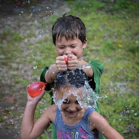 water fight by Matthew Westfall - Babies & Children Children Candids