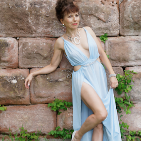 The Diva by Johannes Oehl - People Portraits of Women ( muscular, romanesque, dress, castle, female hairstyle, 12th century, thigh, fashion-photography, apparel, rheinland-pfalz, lower arm, upper-arm, looking at camera, building, frankenstein castle, leg, beautiful, lightblue, up do, one female adult only, rhineland-palatinate, full body, place of interest, medieval architecture, wardrobe, female, costume, ruin, brickwork, pfalz, upper leg, defensive wall, german ethnicity, july, 11 brown iris, thin, red sandstone, person, outside, leaning, lawngreen, stone wall, underarm, brick wall, germany, palatinate, martin-schultz scale, sandstone, 55-60 years, summer, brunette, lower leg, brick, europe, arm, architecture, 1 person, frankenstein, brunet, green, middle ages, sexy, medieval, people-photography, brown eyes, necklace, blank expression, brown hair, clothes, dark mixed eyes, stone, full-length, outdoor, knee, standing, jewellery, blue, full length, outdoors, dark age, fair skin, wall, summertime, fashion,  )