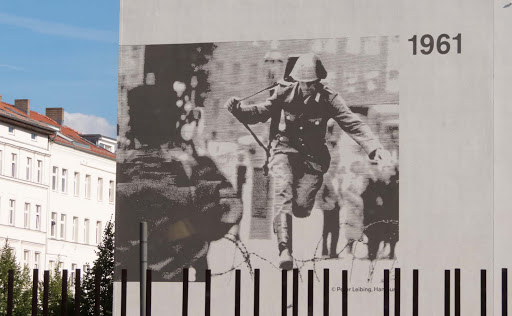 east-german-soldier.jpg -   Peter Leibing's 1961 photo of an East German border guard who successfully escaped but later committed suicide adorns the side of a building at the Berlin Wall.