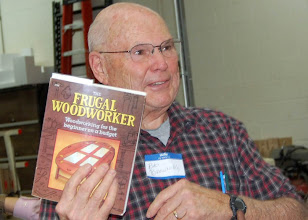 Photo: Bob shows a trick on how to drill a straight hole that he found in the free book he picked up at the last meeting.