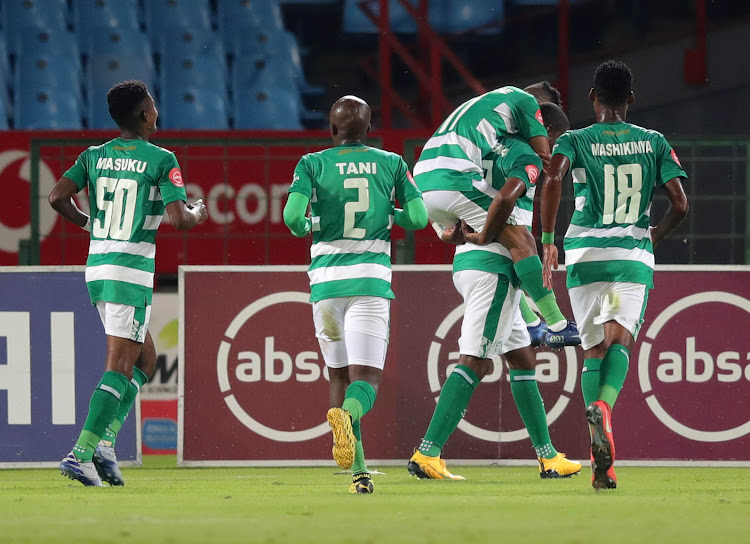 Bloemfontein Celtic captain Ndumiso Mabena celebrates with his teammates after scoring the equalising goal before his Mamelodi Sundowns counterpart Hlompho Kekana scored the winning goal.