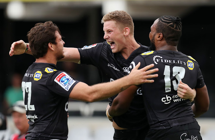 Robert du Preez Jnr. celebrates with teammates during the Super Rugby match between Sharks and NSW Waratahs at GrowthPoint Kings Park, Durban South Africa on the 03 March 2018.
