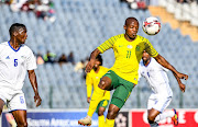 Lerato Lepasa of South Africa and Tshepo Toloana of Lesotho during the CHAN Qualifier 2nd round match between South Africa and Lesotho at Dobsonville Stadium on August 04, 2019 in Johannesburg, South Africa.
