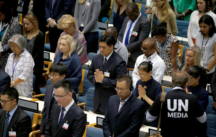 Delegates at the United Nations Environment Programme (UNEP) world environmental forum observe a minute's silence in memory of the victims of Ethiopian Airlines Flight ET 302 plane crash, at the United Nations complex within Gigiri in Nairobi, Kenya March 11, 2019.