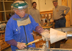 Photo: Phil Brown hollowing a bowl while others look on.
