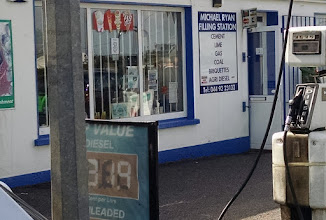 Photo: Check out the sign on the wall of the gas station