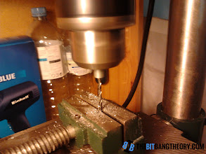 Photo: Lowering the threaded rod onto the drill bit